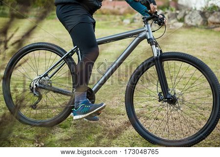 Male mountain biker riding bicycle in forest
