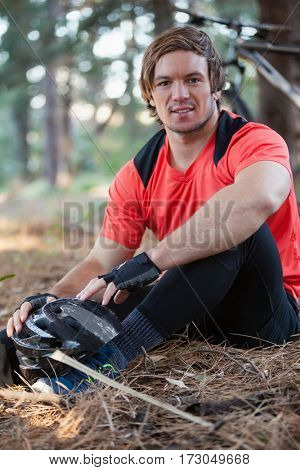 Portrait of male mountain biker in the forest on a sunny day