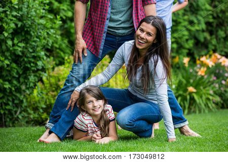Happy family having fun in park on a sunny day
