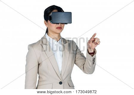 Businesswoman using virtual reality headset against white background