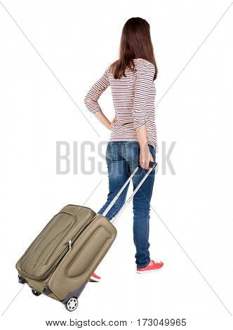 back view of walking  woman  with suitcase. beautiful brunette girl in motion.  backside view of person.  Rear view people collection. Isolated over white background.