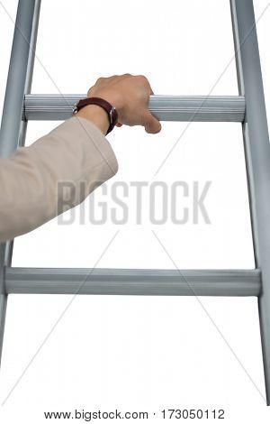 Businesswoman holding ladder against white background