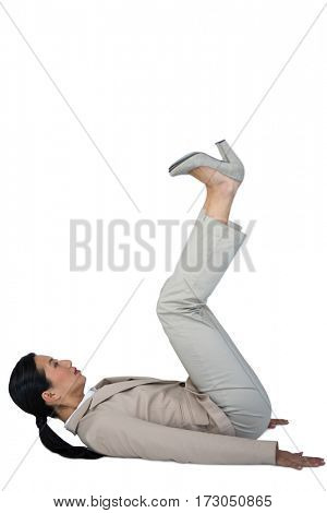 Businesswoman performing exercise against white background