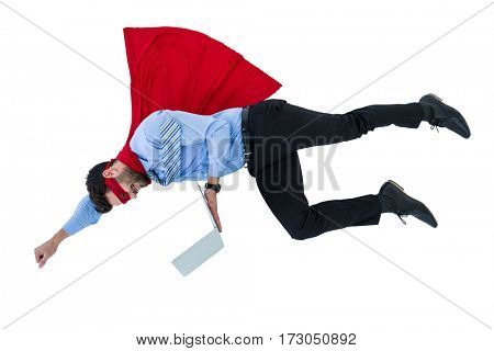 Businessman pretending to be a super hero holding laptop on white background