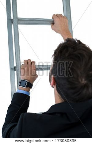 Businessman climbing ladder on white background