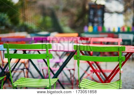 Bright Colorful Tables Of Parisian Outdoor Cafe On Montmartre