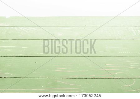 light green wooden background with horizontal planks on white