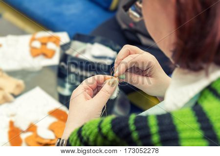 Woman Hands Stitches Synthetic Fur Pieces
