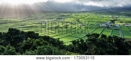 Backlit with sun ray lights of farm fields in the Terceira island in Azores, Panorama