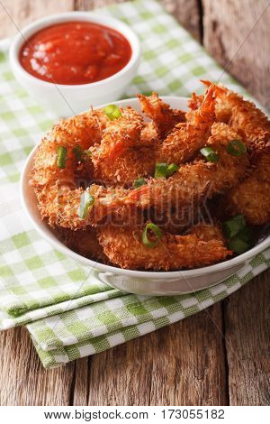Gourmet Snack: Coconut Shrimp Close Up In A Bowl And Tomato Sauce. Vertical