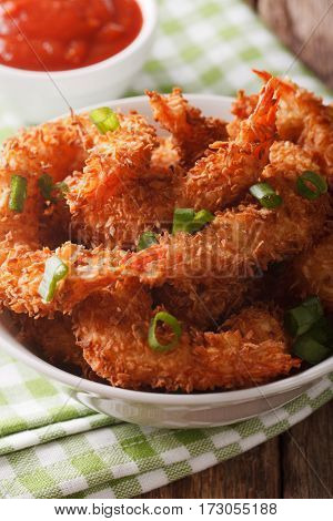 Delicious Coconut Shrimp With Green Onions Close-up In A Bowl And Tomato Sauce. Vertical