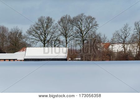 Dutch Farmland With Farm Covered In Snow.