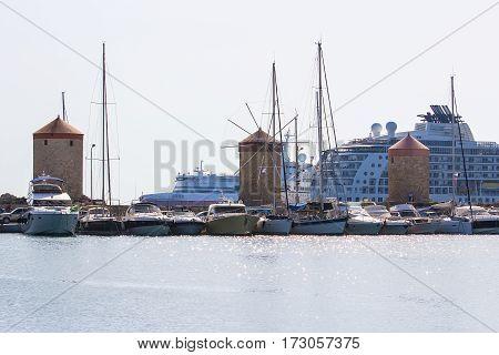 Rhodes island landmark, Mandraki Port, many white large yacht at anchor
