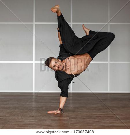 Young guy dancing indoors. Dance man in room