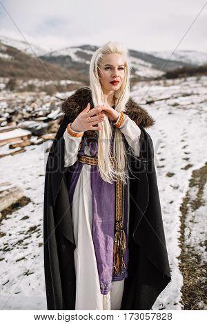 Portrait Of A Beautiful Blonde In A Black Cape, Viking