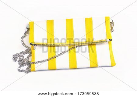 The little striped handbag (white and yellow bright color).fashion leather a bag purse clutch on white background isolated