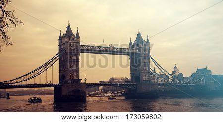 Retro styled photo of Tower Bridge in the sunset, London, UK