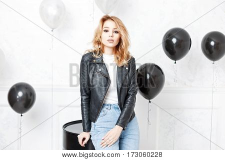 Stylish Beautiful Woman In Trendy Black Jacket Standing Near Black Balloons