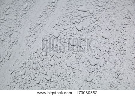 abstract background. Water drops on the gray metal surface
