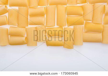 top view of small raw macaroni italian pasta on white
