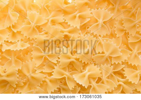 top view of small raw macaroni italian pasta for background