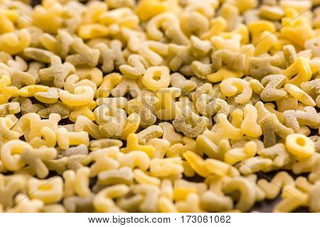 close up view of raw macaroni alphabet letters