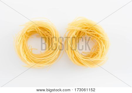 Uncooked classical italian pasta isolated on white