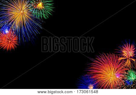 Colorful fireworks shot off in the night sky in the corner of the picture