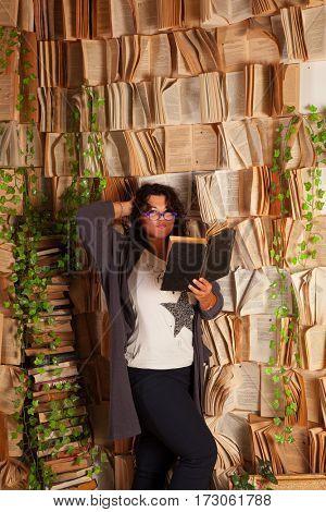 Beautiful brunette near books wall