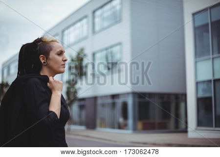 Thoughtful businesswoman looking away in office campus