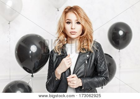 Stylish Young Woman In A Black Leather Jacket Near Black Air Balloons