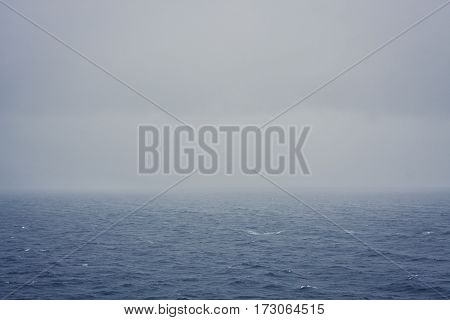 Severe rain falling into the sea during a storm