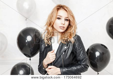 Beautiful Young Woman In A Black Leather Jacket Near Black Air Balloons