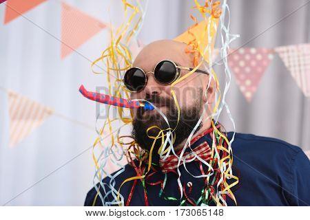 Funny fat man celebrating birthday at home