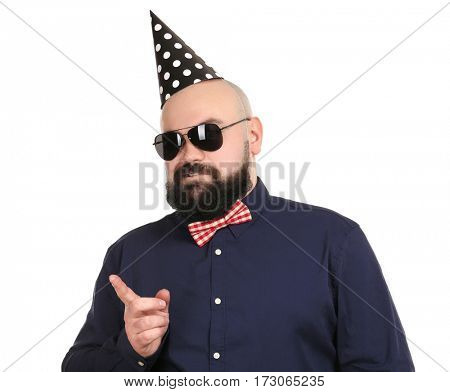 Bearded fat man with party hat on white background
