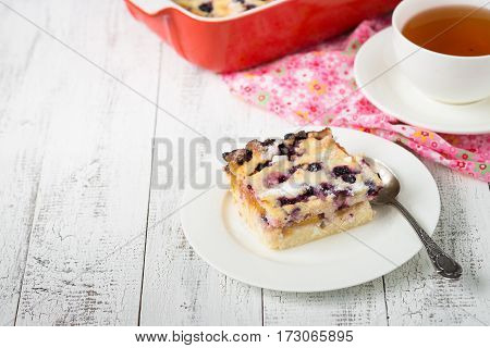 Cottage cheese casserole with peach fruit and blueberry. Healthy breakfast or snack.