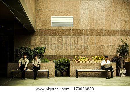 Employees Taking A Smoking Break