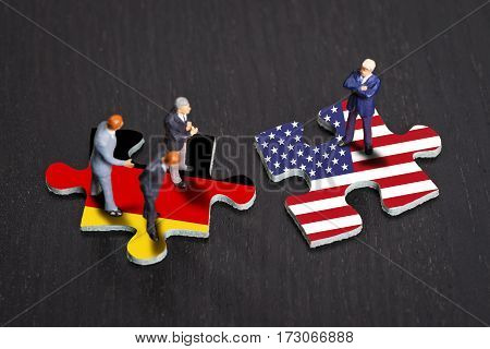 Puzzle pieces with the flags of Germany and the USA
