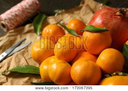 Set of tangerines and juice fruits on wrapping paper