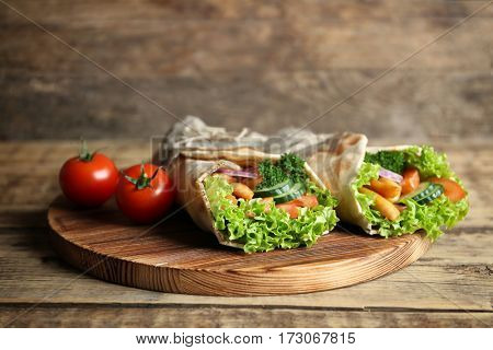 Delicious kebab sandwiches on wooden board