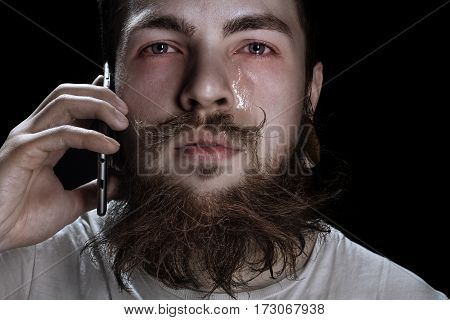 Crying Bearded Man Holding A Smartphone Near Your Ear
