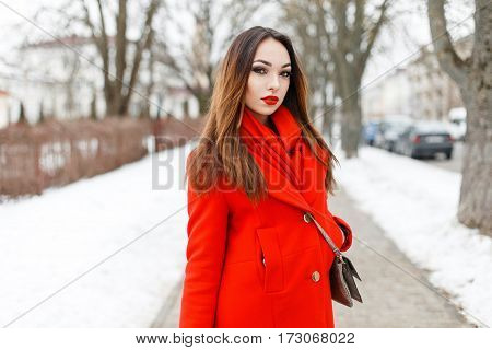 Beautiful Brunette Girl In A Red Dress Walking In A Winter Day