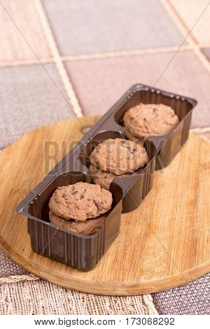 Brown Biscuits Cookies With Chocolate In Plastic Packaging
