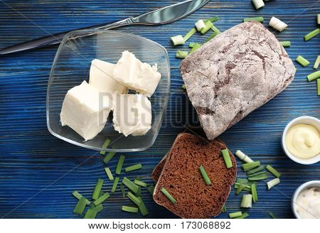 Wooden cutting board with sliced loaf of beer bread and butter