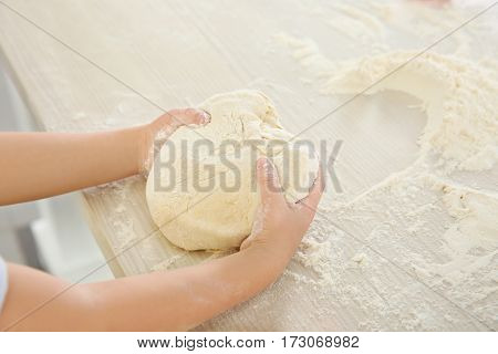 Little kid making biscuits on table
