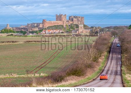Bamburgh Castle is in Northumberland on the North East coast of England, it is perched on a basalt outcrop overlooking the North Sea. Close to The Farne Islands & Holy Island: Bamburgh, Northumberland, England, UK March 15 2016.