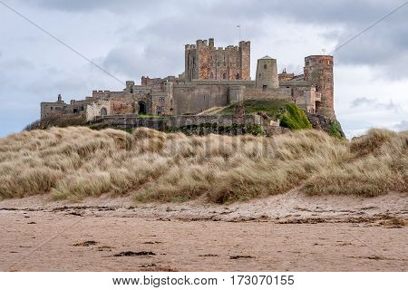 Bamburgh Castle is in Northumberland on the North East coast of England it is perched on a basalt outcrop overlooking the North Sea. Close to The Farne Islands & Holy Island: Bamburgh Northumberland England UK March 15 2016.
