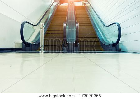 An escalator in department store with sunshine.