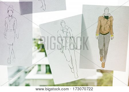 Fashion design sketching paper on the window wall