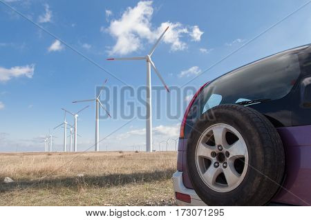 SUV offroad vehicle at wind turbine farm